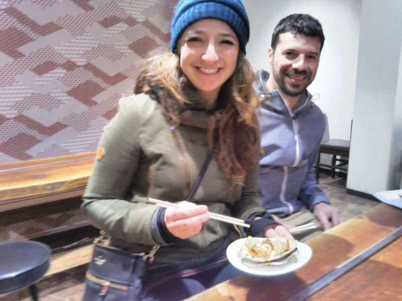 A couple from New Orleans trying Takoyaki