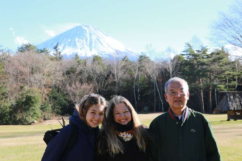 In front of Aokigahara Forest and Mt. Fuji. Aokigahara Forest is an ancient forest on a lava plateau stretching over the northwest base of Mount Fuji. It is best to go inside with a guide as it is very easy to get lost among trees.