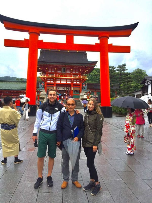 in front of Torii Gate at Fushimi Inari Shrine