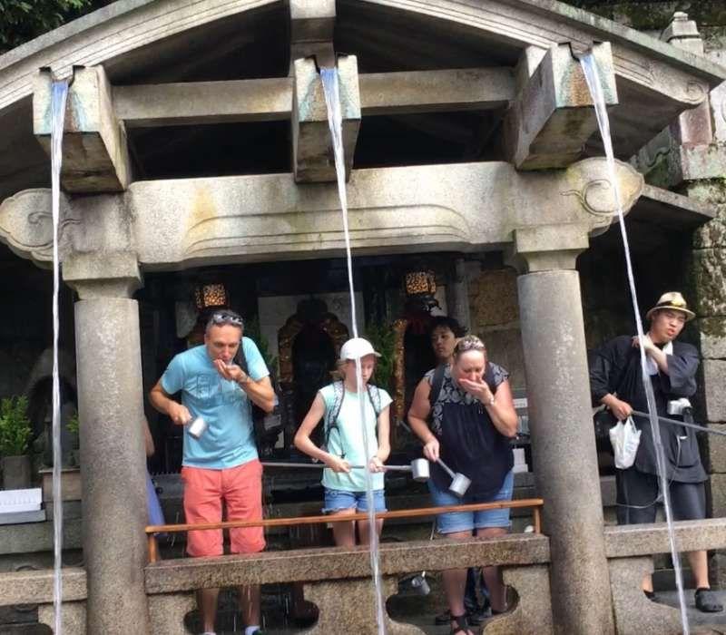praying for wishes at Otowa-taki Water Fall in Kiyomizudera
