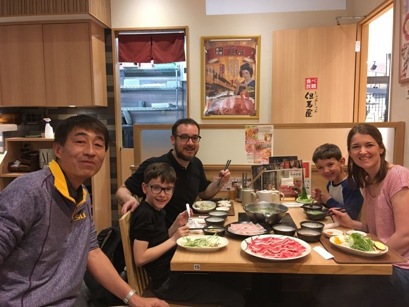 Eating Shabu-Shabu with an American family.