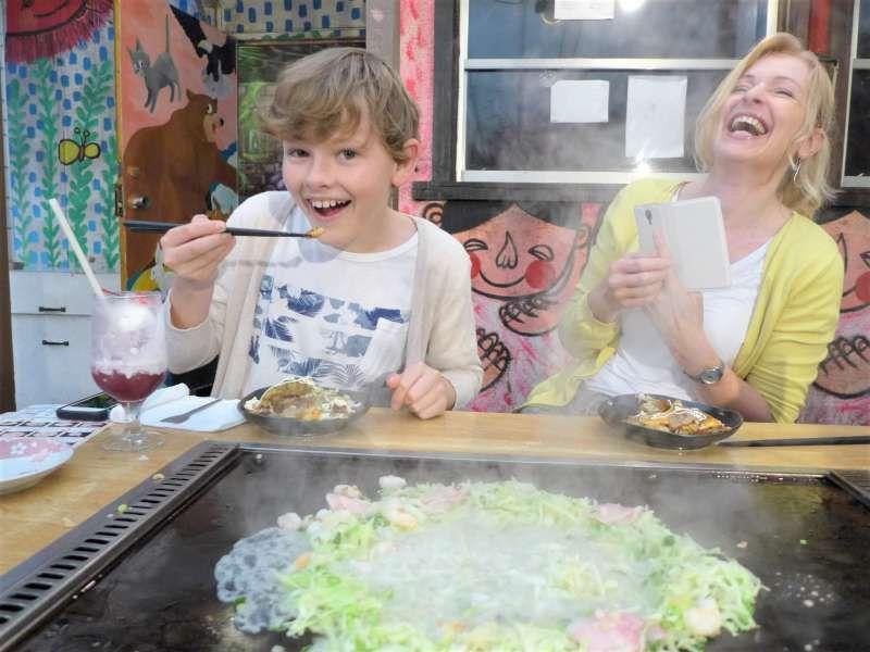 How about eating Okonomi-yaki, Japanese vegetable pancake? You will enjoy it!
