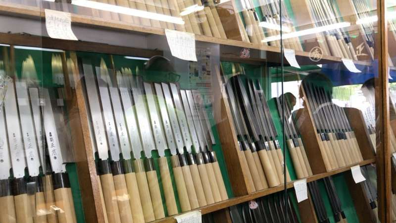 Japanese kitchen knives. They show you how to shapen them.(Tsukiji)