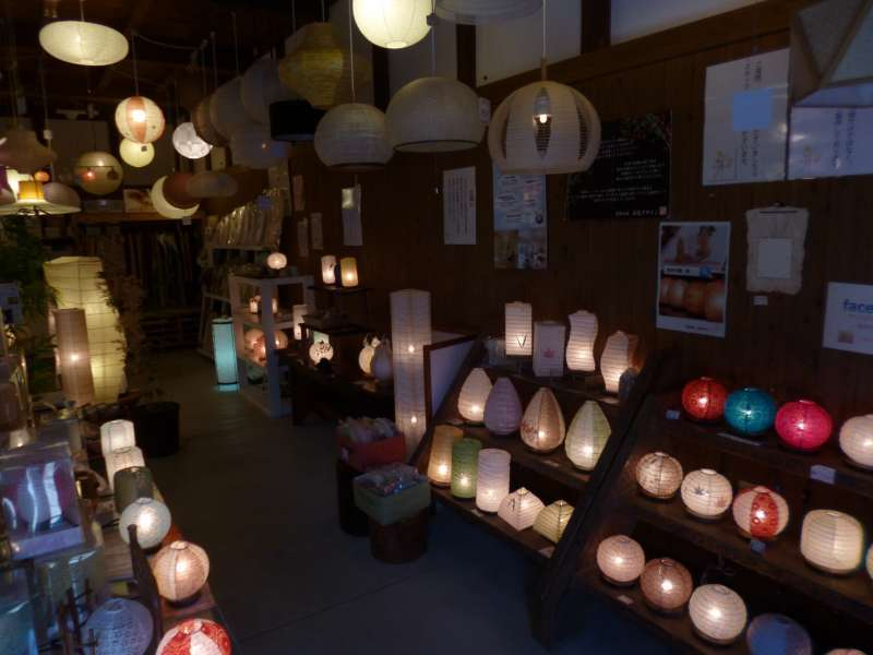 A cozy lantern shop in an old wooden building. All those electric lights covers are made of Mino-Washi.