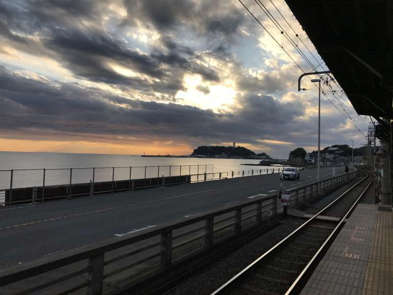 A sunset beyond Enoshima Island from an Enoden Railway station in Southwestern Kamakura Area.