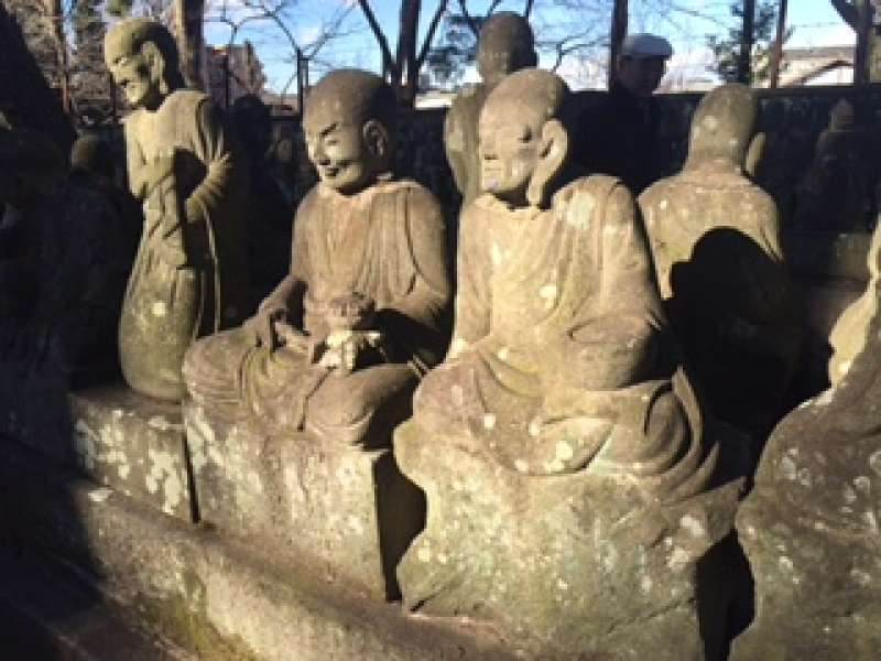 500- hundred stone Buddha statues welcome you.
