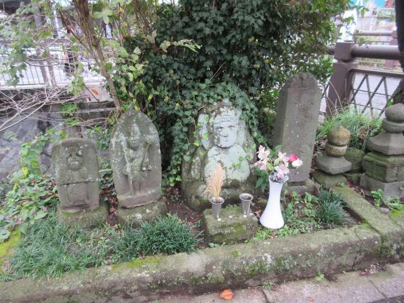 Old stone Buddha along road