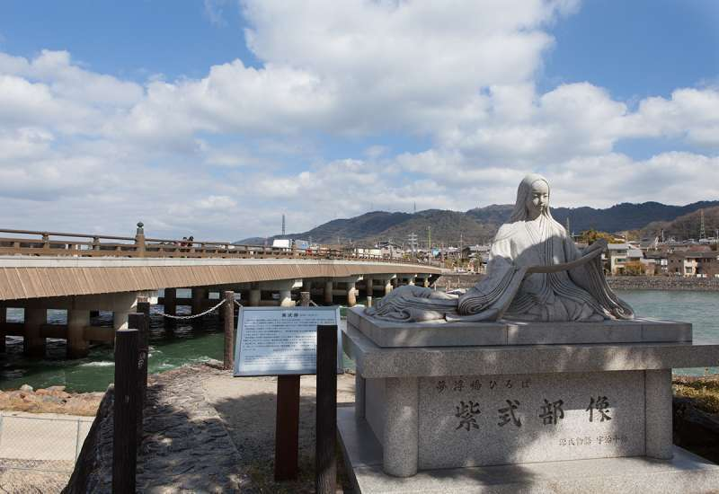 The stone statue of Murasaki Shikibu, author of the Tale of Genji, the oldest novel in the world, near Uji Bridge.
