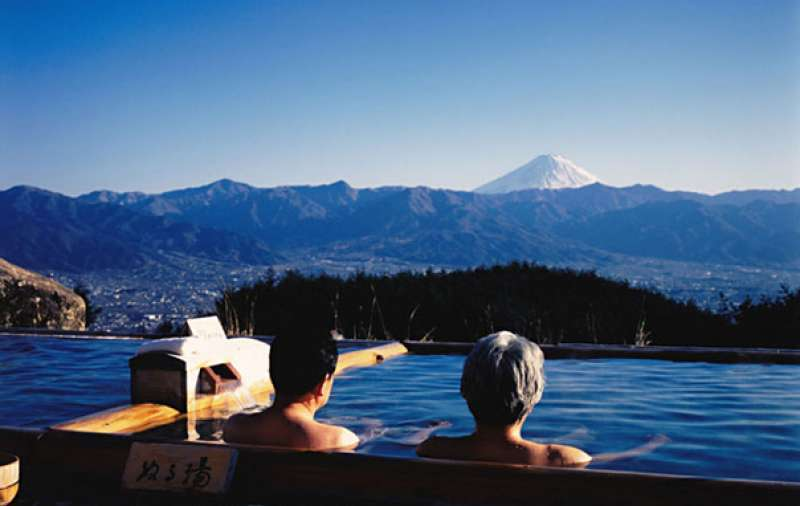 You can see Mt. Fuji (35 km south) when taking a public bath with local Japanese at the tip of the mountain.
