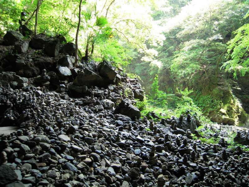 Amanoyasugawara shrine.  You'll be amazed to see those thousands of piles of stones in this place.