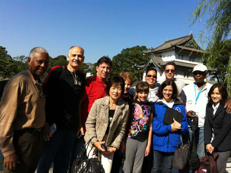 On Imperial Palace grounds with a samurai castle in the background. (C1)
