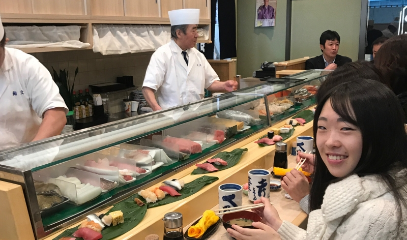 Watch sushi chefs make sushi in Tsukiji. The tuna melts in your mouth! (C2)