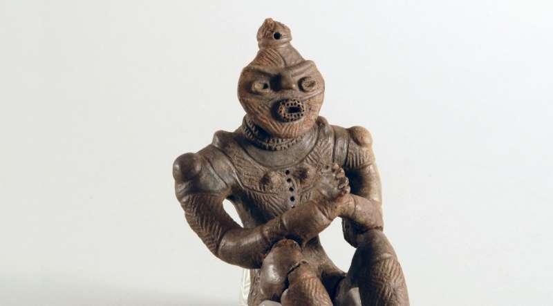Gassho Dogu clay figurine with clasped hands