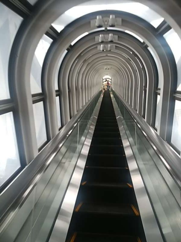 unique see-through escalator to the 39th floor from the 35th floor