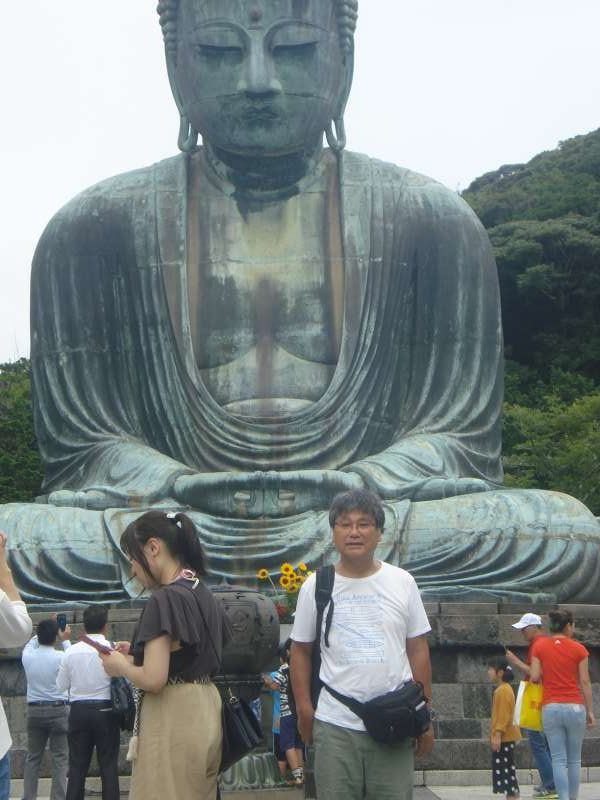 With the Great Buddha of Kamakura in Kotokuin Temple in Hase. You can get inside the statue. To the right of it, there is a big pair of straw sandals of the Buddha. Behind is a shady quiet place where a stone monument stands, on which engraved a poem about the Buddha by the famous poet Yosano Akiko.