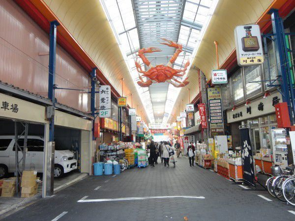The signboard of  crab is hanging on the roof at Kuromon market.