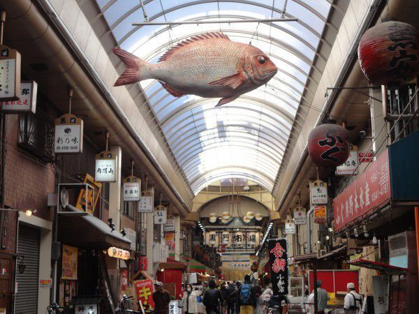 The signboard of seabream is hanging on the roof at Kuromon market.