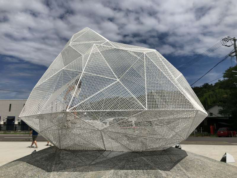 Naoshima Pavilion comprised of approx. 250 pieces of stainless steel network, designed by a hopeful architect, Sou Fujimoto