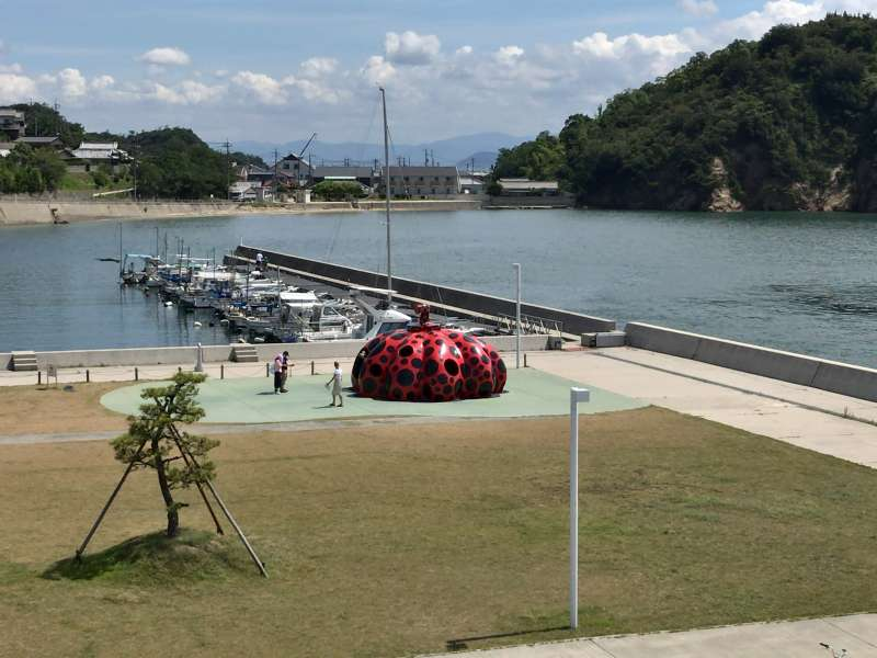Red Pumpkin placed at Miyanoura Port welcomes you