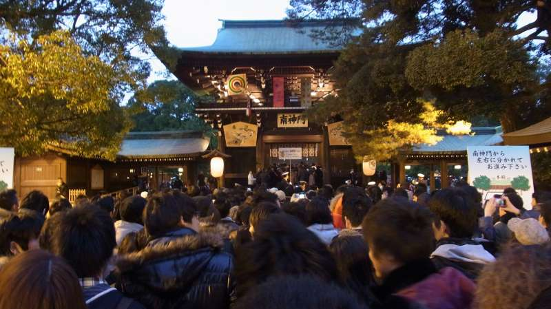 Hall of worship inside Meiji Shrine and many people who are coming to pray for their happy life