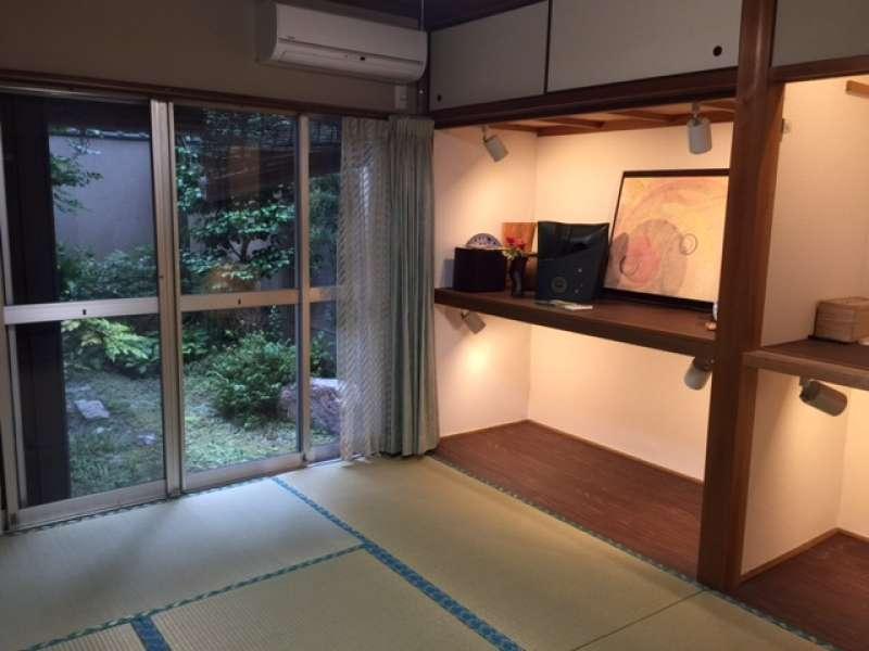 Here is tatami mat floor and exhibit of handy leather crafts work. Visitors enjoy green tea in my villa.