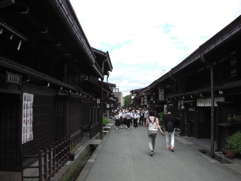 The shoppping street with traditional houses in Takayama