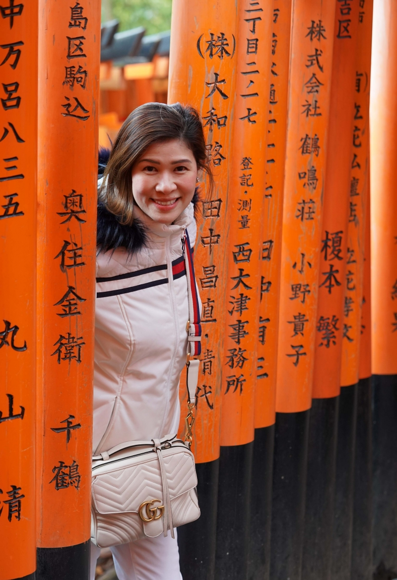 Memorable Portrait picture for my guest taken with Torii gates of Fushimi Inari Taisha shrine