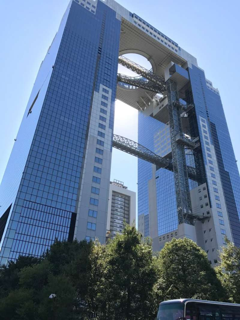 Umeda Sky Building. It is located northern part of Osaka station, Umdea area. In 1993, the 170 meters building was completed by adopting an advanced architectural method. It was designed by famous Japanese architecture, Hiroshi Hara.