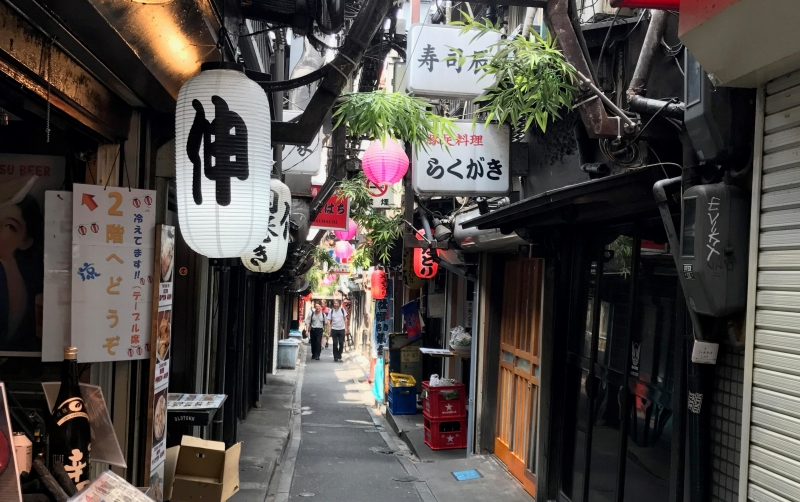On the narrow streets there are many small eateries and pubs. (#2)