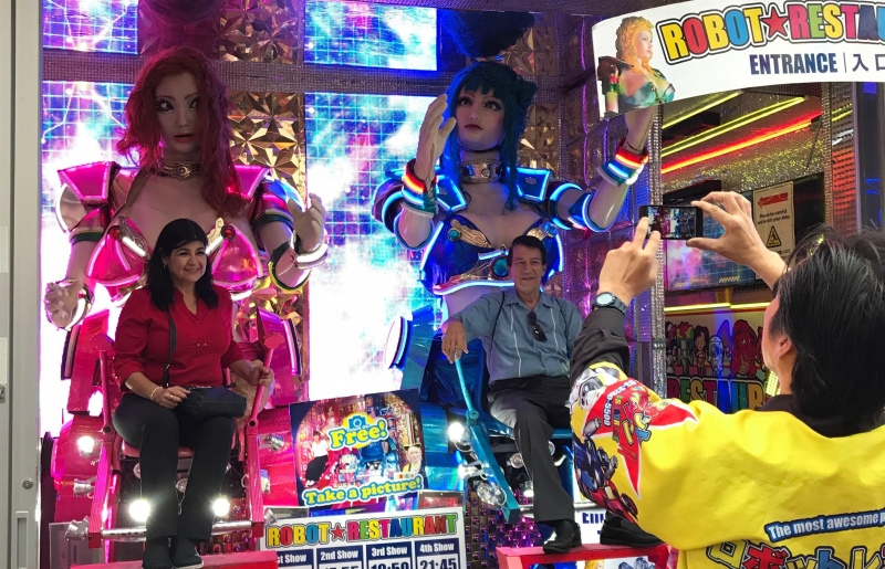 You can take your photo on the robot chair at the Robot restaurant. (#3)