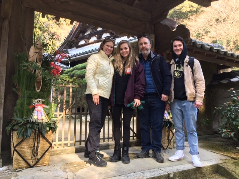 Lovely family from the USA at the entrance of a temple