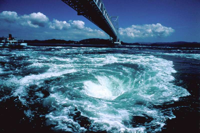 Naruto is the part of Tokushima Prefecture, Naruto is known for its swirling whirlpools. These can be seen in the Strait of Naruto underneath the Onaruto Bridge connecting Tokushima to Awaji Island.