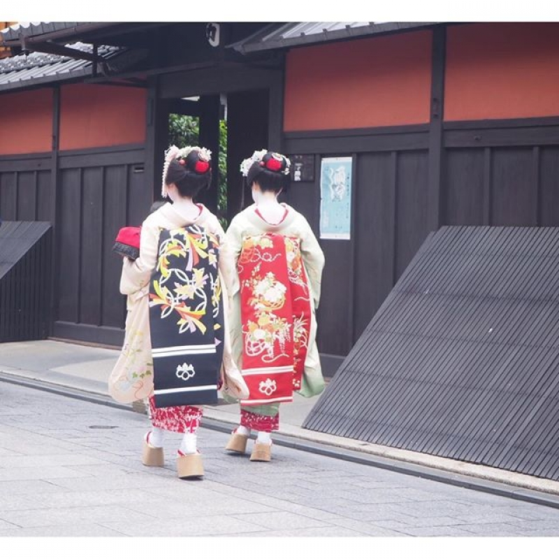Maiko on an alley in Gion downtown area