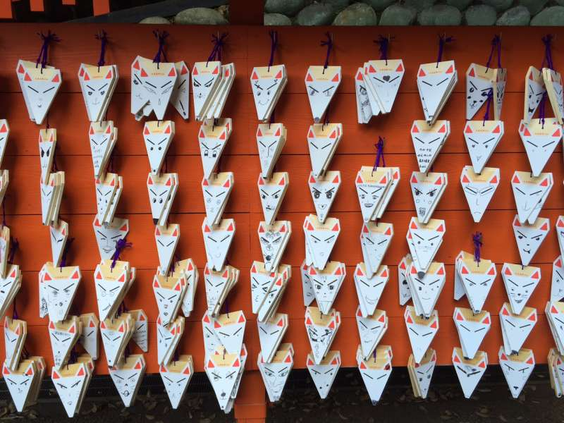 Picture tablets in the shape of fox at Fushimi-inari.