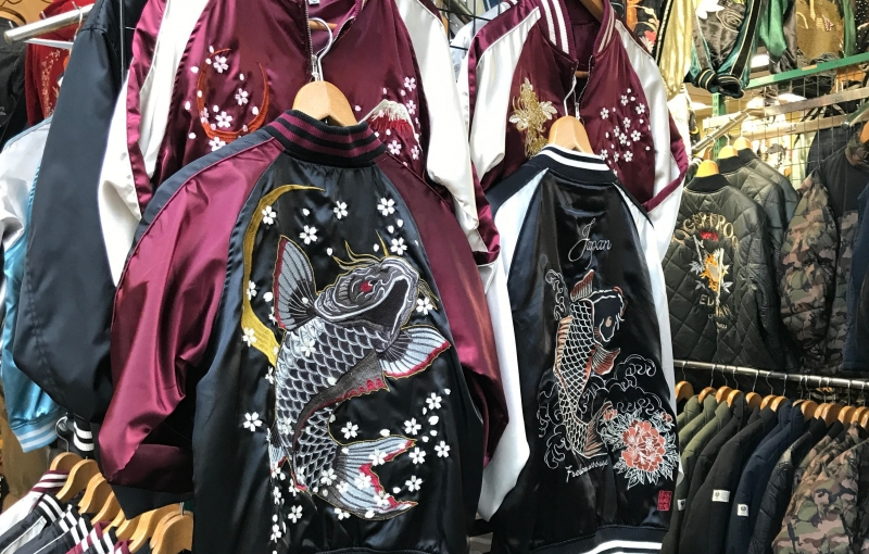 Intricately embroidered jackets at Ameyoko. They have a wide variety of items on sale, from food to fashion. Looking for a pub? They have those too! (Option D)