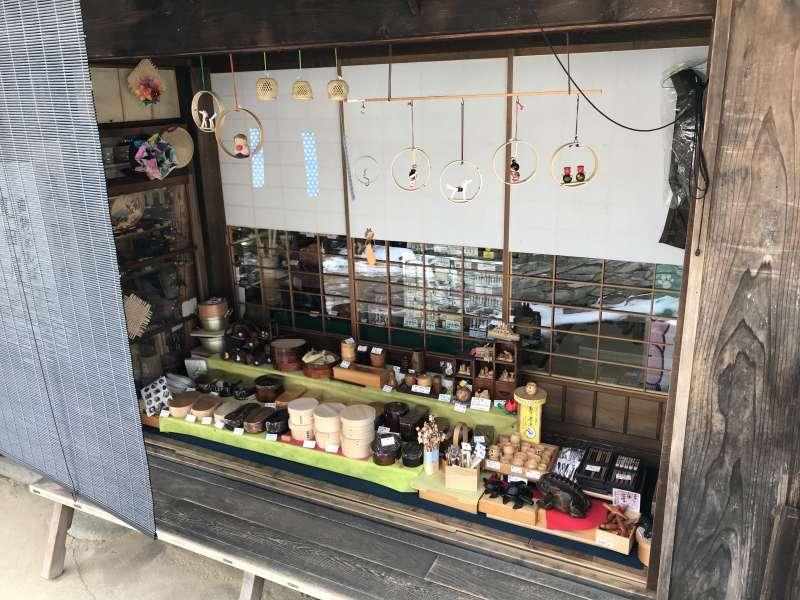 A variety of local handmade goods are sold in a part of the veranda of a house.