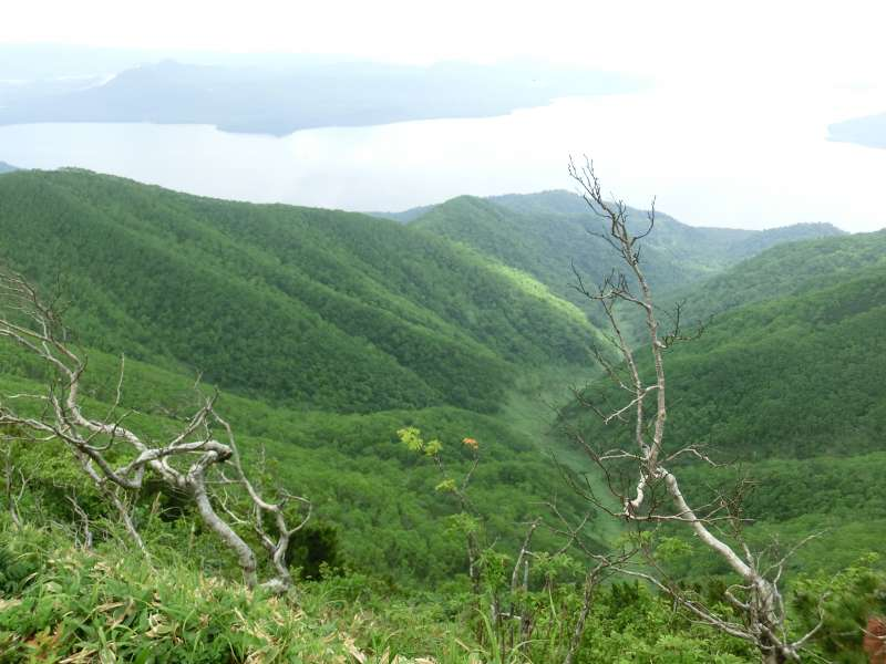The view from the top in summer. You can see the Lake Kussharo, which is the largest crater lake in Japan.