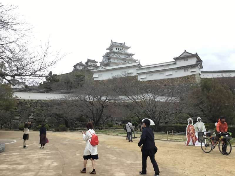 At the entrance of Himeji castle, you can see the castle tower in the distance.
