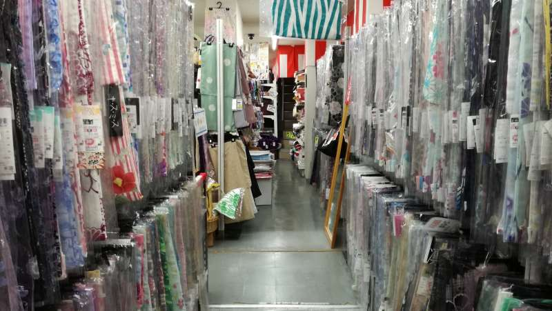 Inside of kimono discount shop. There are many YUKATAs (=casual kimonos for summer time), from 3,000yen to 20,000yen.