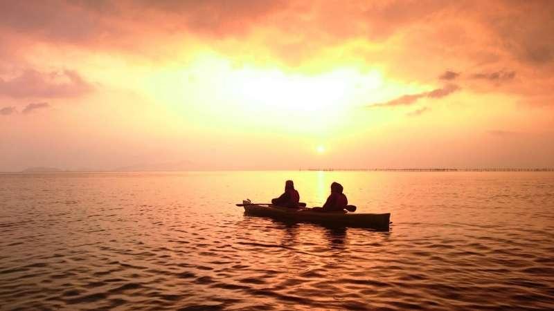 Tandem Kayak in the sunset