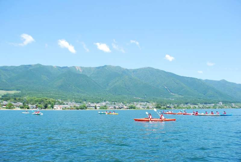 Tandem Kayak on the lake with Hira mountains in the background