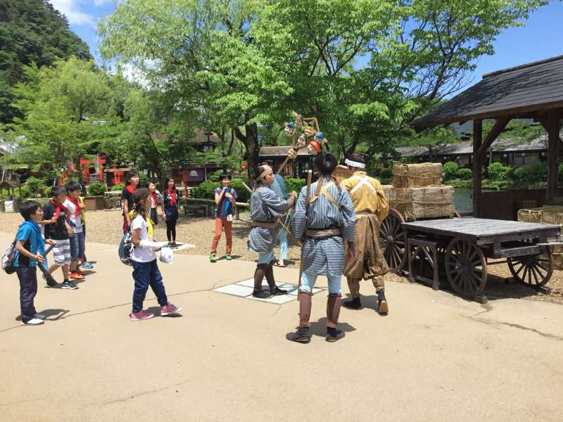 Samurai tied with topknot, town girls wearing Kimono and Ninja inside Edo Wonderland.
