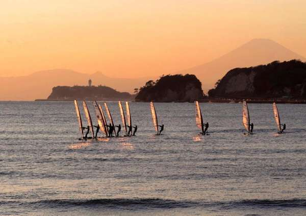 Wind surfers and Mt. Fuji in the sunset