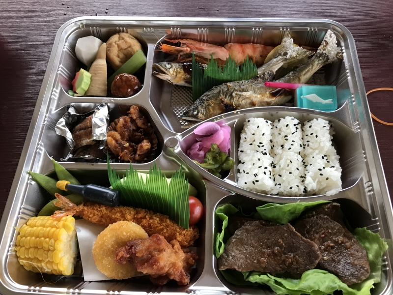 A special dinner box: grilled sweet-fish Ayu,beef, deep-fried shrimp, a variety of vegetables, rice etc.