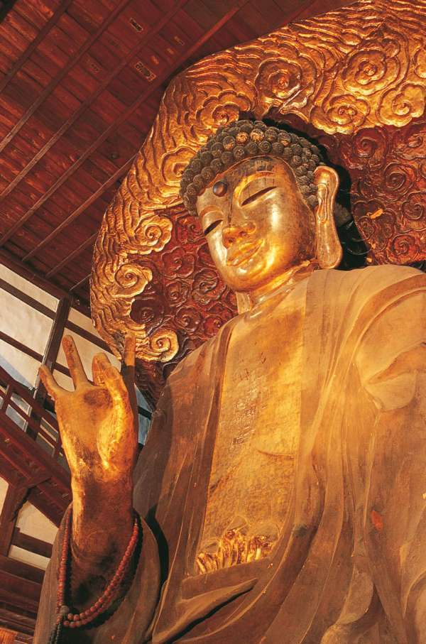 Daibutsu in Shobo-ji temple houses one of the three Great Buddha statues of Japan. It stands 13.7m tall and is made of lots of paper sutras.