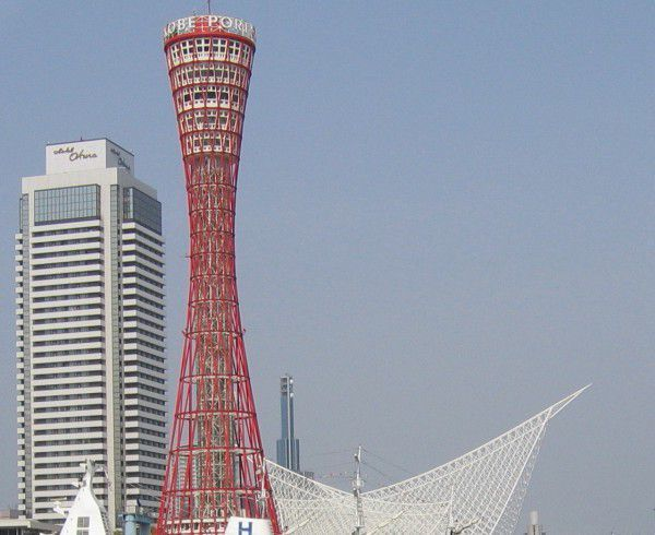 The red Port Tower, the city's landmark, creates a beautiful contrast against the white Kobe Marine Museum, inspired by waves and sailing ships.