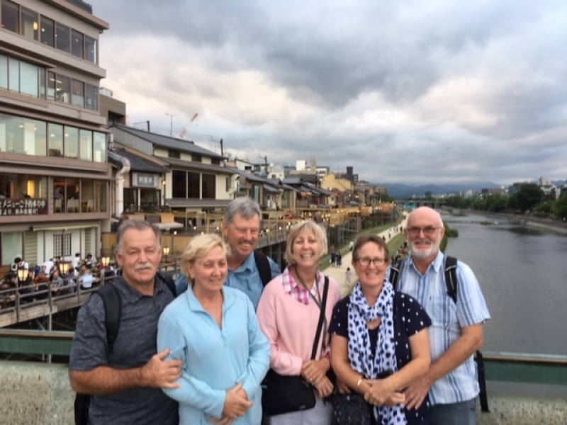 Cheerful group and Kamogawa River at Shijo Kawaramachi
