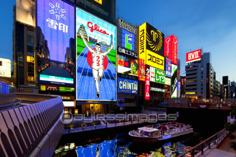 Dotonbori restaurants street. Very famous Glico runner greets you with illumination at night.