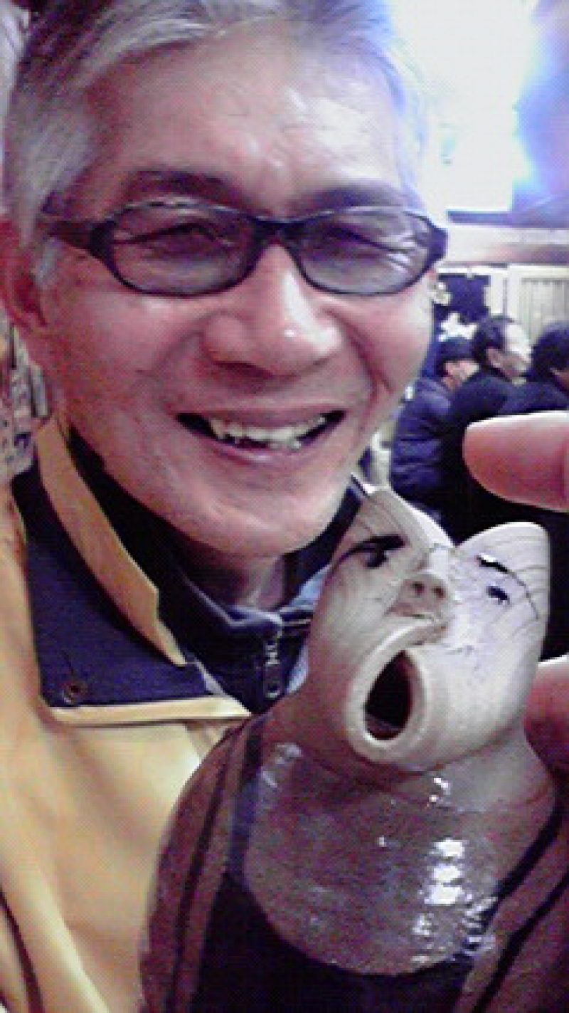 At my favorite pub, izakaya with my own sake bottle. He is my friedn I found n the slope to Kiyomizu temple, Kyoto 45 years ago.