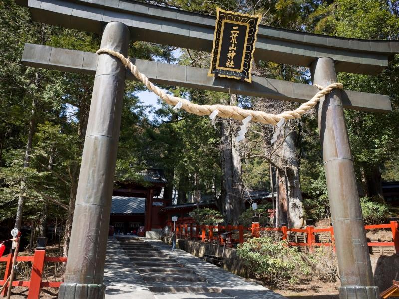 Futarasan Shrine's Torii gate, sacred atmosphere surrounded by giant cedar trees along.